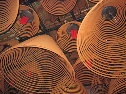 Incense cones hanging from the ceiling